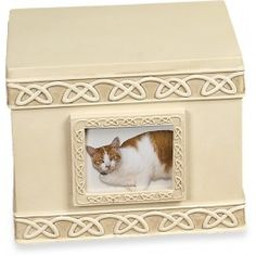 A lovely box-shaped urn to hold your forever friend's ashes.  This urn can be placed in a special spot in your home to remind you of your cherished pet. $54.99