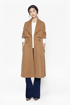 This tan coat from French Connection is perfect for every Fall occasion! Style it today in Covet Fashion.