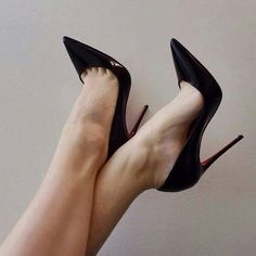 Black pumps, arches, and toe cleavage in the air.   ( this may have been pinned before, but it can't be seen enough. )