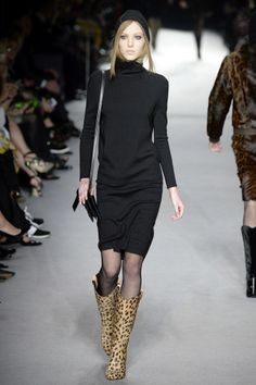 Tom Ford AW14 - Look 13   Black Milano fine cashmere hooded dress.  Black calfskin icon shoulder bag.  Cheetah-printed calfskin cowboy boots.