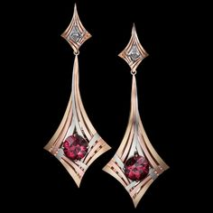 Rouge Moderne Earrings feature exotic red Zircons surrounded by three sweeping, architectural lines of gold and capped with kite shaped white diamonds.
