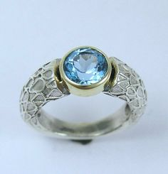 Sterling silver and yellow gold ring with blue topaz stone - day by day.