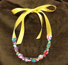 Fabric covered bead necklace with ribbon to tie. Easy and fun to make it! (Lots of online tutorials)