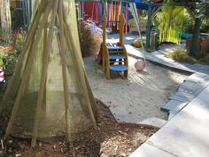 Outdoor soft tepee play area at the Child Development Center at Grossmont College. Image by Anna Day ≈≈ I love how it's on a different surface than the sand area. For more inspiring pins: http://pinterest.com/kinderooacademy/preschool-outdoor-play-environments/
