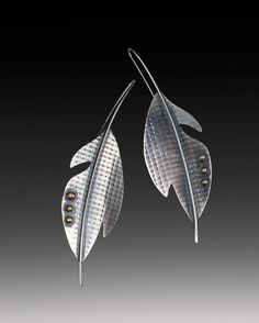 Elegant handcrafted long sterling silver and brass leaf earrings by tomlindesign on Etsy https://www.etsy.com/listing/125386618/elegant-handcrafted-long-sterling-silver