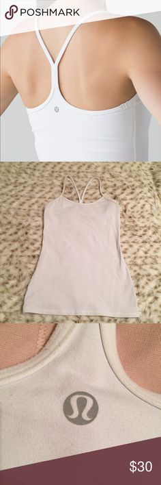 Lululemon white power y tank Lululemon size 6 ! Power Y Tank ! In great condition! I cracking on the lululemon symbol! No stains! Doesn't come with removable padding lululemon athletica Tops Tank Tops