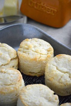 These easy and simple Gluten Free Biscuits are a adapted from my mom's biscuit recipe. These buttery, flaky, fluffy gluten free biscuits are everything you want in a biscuit! Gluten free biscuit recipe from @whattheforkblog | whattheforkfoodblog | easy biscuit recipe | how to make biscuits | gluten free biscuits and gravy | fluffy gluten free biscuits | gluten free dairy free biscuits | dairy free option | homemade biscuits | breakfast biscuits