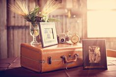 use antique suitcase and knick knacks for decor along with framed photos of you two
