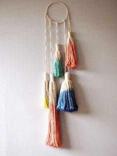 Create a colorful tassel dreamcatcher for your room.