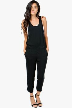 An incredibly chic jumpsuit with a polished chiffon body. Elongated armholes. Drop waist. BOUTIQUE FIVE.