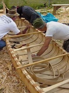 Tribal members work together to craft a birch bark canoe, courtesy of Penobscot Indian Nation.