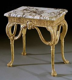 c1710 A QUEEN ANNE GESSO SIDE TABLE ATTRIBUTED TO JAMES MOORE THE ELDER  English, circa 1710     Height: 29 ¼ in; 74.5 cm   Width: 29 ¼ in; 74.5 cm   Depth: 19 ¼ in; 49 cm