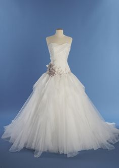 A woman wearing the Sleeping Beauty wedding gown from the Alfred Angelo Bridal Collection