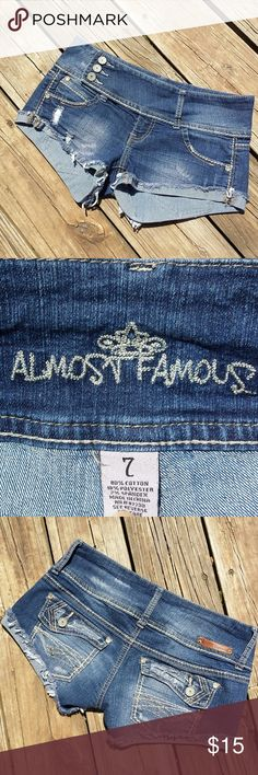 Almost famous short shorts Almost famous short shorts  Size 7  Cuffed bottoms  Three visible buttons one hidden button small zipper  Worn only a time or two  To short for this mommy Almost Famous Shorts Skorts