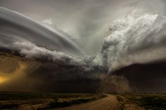 Clash of the storms, New Mexico, US: Camelia Czuchnicki  A clash between two storm cells in New Mexico, US, each with its own rotating updraft. The curved striations of the oldest noticeable against the new bubbling convection of the newer. It was a fantastic sight to watch and it's the rarity of such scenes that keep drawing me back to the US Plains each year.