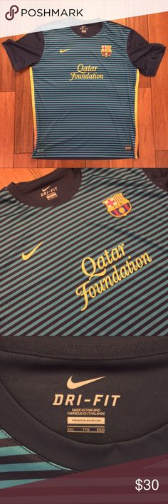 Nike FC Barcelona Authentic Training Jersey - XXL Nike FC Barcelona Authentic Training Jersey  SIZE: XXL  CONDITION: Pre-Owned - EXCELLENT CONDITION  Nike FC Barcelona Authentic Training Top.  BARCA printed across the shoulder blades.  Jersey is in excellent condition - worn less than five times. Nike Shirts Tees - Long Sleeve