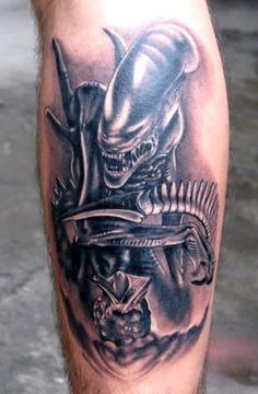Wonderful alien predator tattoo on leg