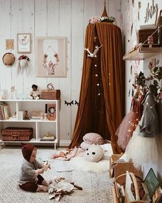 A canopy or tent creates an instant sense of coziness. But add to that some fairy lights, lots of softies and a sheepskin rug and you'll have a perfect little place for the little ones to read, snooze or dream. We're loving the deep mustard tones too which adds to the feeling of warmth #kidsroom #kidsroomdecor #petitandsmall