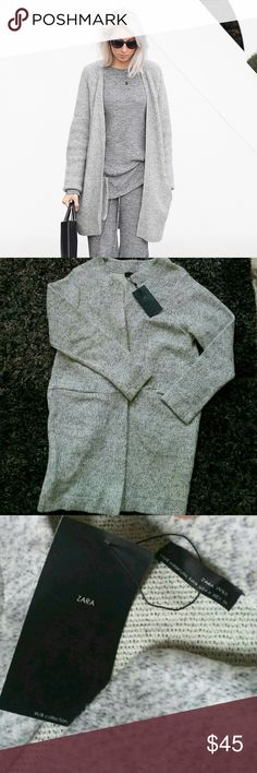 Zara Oversized Grey Cardigan. NWT! Sold out everywhere! Never worn, can be worn as oversized, runs large. Super comfy and cozy knit/wool material. Firm on price, no trades; serious buyers only please. Zara Sweaters Cardigans