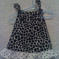 White with black polka dots giraffe print. Nb, s, m, l, xl. $22. Free shipping.
