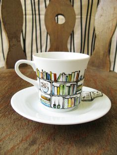 Hand drawn and painted porcelain teacup and saucer for a bookworm