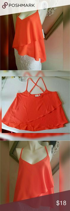 """Bisou Bisou Tank Top NWT. color orange nasturtium. Criscross Racer back. Adjustable straps. Flowy. 100% polyester.  Measurements  Large Length 25""""  Bust 39"""" - 40.5""""  Waist 32"""" - 33.5""""   Get an additional 30% off when purchasing 3 or more items using the bundle feature. Always willing to negotiate. Bisou Bisou Tops Tank Tops"""