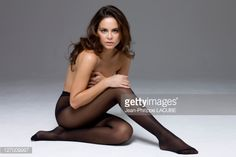 Topless woman wearing tights : Stock Photo