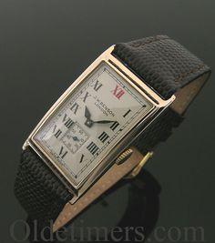 A 9ct rose gold rectangular vintage JW Benson watch, 1934