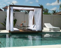 Awesome Square Wooden Design Of Patio Daybed Around Modern Pool Also White Lounge Chairs  Gorgeous Patio Daybed cheap outdoor daybed. outdoor covered daybed. outdoor wicker lounge bed. round outdoor bed. covered outdoor daybed. . 600x473 pixels