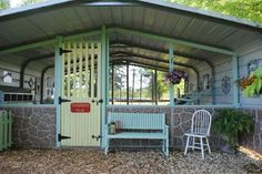 """Carport turned chicken coop or rabbitry with a covered """"porch"""""""