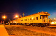 qstation:  Repurposed But Still Classy by The_Midland_Railfan on Flickr.The two cars on a BNSF Geometry Train bask in the artificial light of the Galesburg, Illinois Amtrak station.