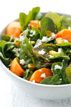 A delightful winter salad featuring persimmons, pistachios, goat cheese, and blood orange vinaigrette