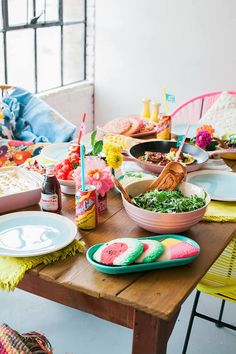 Colorful outdoor party decor ideas: A Bright and Colorful Fiesta ~ This may be a Cinco de Mayo-themed party, but there is no reason this fiesta can't inspire your outdoor summer entertaining (Can you find the Fiesta® Dinnerware?) | Darling Magazine