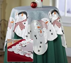 """Holiday Snowman Embroidered Decorative Table Topper By Collections Etc by Collections. $10.99. Give an end table, dresser, or vanity a luxurious splash of wintertime fun. Topper features an all-around border of festive and oh-so charming snowguys and snowgals, embroidered with carrot noses, magical hats and charming checkered scarves. Drape over a round accent table or atop a dining table. Polyester; imported. Machine wash. 33""""Square."""