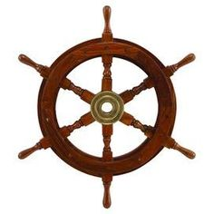 """Add nautical appeal to your entryway or living room with this wood and brass wall decor, showcasing a ship's wheel silhouette.  Product: Wall decorConstruction Material: Wood, brass and polystoneColor: BrownDimensions: 18"""" H x 18"""" Diameter"""