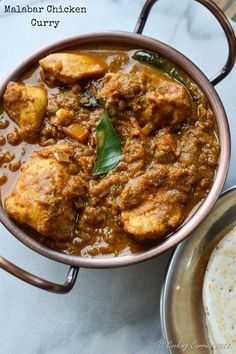 Malabar Chicken Curry - Coconut, pearl onions and spices bring together the chicken in this spicy and delicious Malabar Chicken Curry. You can dip and slurp your way through this for you lunch and dinner with some rotis, appam or even slices of bread!