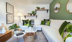 Green living rooms are modern, elegant and stylish. Whether it's adding a lime green accent wall or showcasing a mint green couch, we've rounded up the best green living room designs. Living Room Green, Interior Design Living Room, Living Room Designs, Living Room Decor, Living Rooms, Color Interior, Room Wall Colors, Living Room Photos, Living Room Inspiration