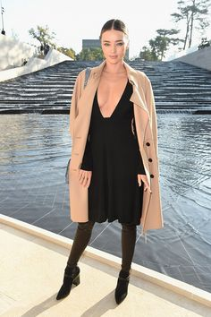 Miranda Kerr goes head-to-toe in Louis Vuitton with a taupe coat, black dress and shoes. // #Celebrity #PFW