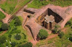 Ethiopia. Ancient Bed Rock Church of St. George located in Lalibela. The church is carved from solid rock in the shape of a cross. It is known as the Eighth Wonder of the World. How it was built is still a mystery.