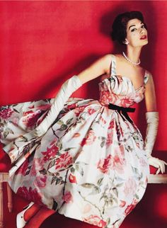 Evening Gown by Pierre Balmain (1953) Printed silk, pleated and boned, with appliqué decoration, net and nylon.
