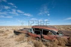 antique cars: Old rusted car in the middle of New Mexico desert