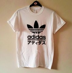 unisex adidas T-shirt top mens medium womens one size will fit 6/8/10/12 depending on the look you want would give a great grunge look on trend