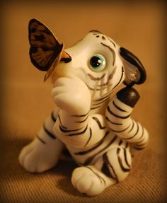 white tiger and butterfly by melinaminotti on DeviantArt