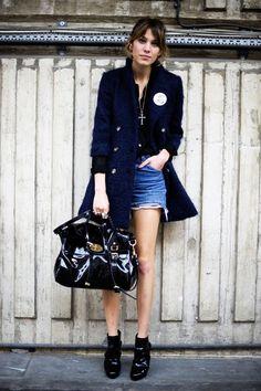 Alexa Chung in cutoffs, a coat, booties, & oversized bag.