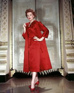 Deborah Kerr decked out in an absolutely beautiful ruby hued ensemble, 1953.