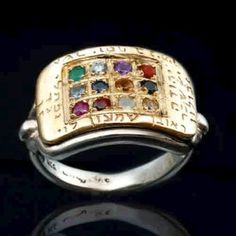 Twelve Tribes of Israel Ephod Stones Ring - from the HaAri Kabbalah jewelry collection.  Ephod stones inlaid in gold. The stones were worn by the high priests of the Israelites. The twelve stones represent the twelve tribes. The names of the tribes are engraved on the ring.