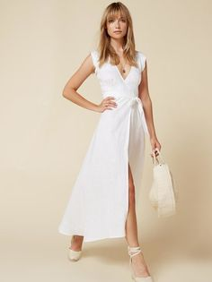 South of France, anyone? This is a calf length, wrap dress with a cap sleeve, v neckline and side slit.