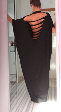 Open Back Black Plus Size Oversized by cherryblossomsdress on Etsy, $89.00. If you want a hot night I think this would do the trick.