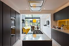 Interesting use of long thin through space - three zones but we wouldn't need such a lot for the kitchen.    Interior design ideas: Lighten Up - in pictures | Life and style | The Guardian