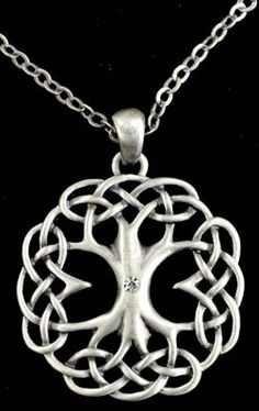 """A wonderful Celtic Tree of life with a tiny shining jewel at the center of its bole. Has 22"""" adjustable chain. Fine Pewter, man made crystal. 1 1/4"""""""